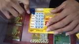 挑战666刮刮乐6万奖金,彩票店老板帮刮第5张中了,赢多少大奖?