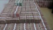 跨境网络赌博嫌犯家藏8000万现金,民警:钱发霉了他也不敢花