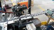 实拍为轴承安装滚珠的生产线
