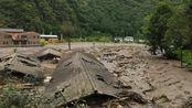 四川暴雨引发山洪致卧龙景区7人失联,上万游客滞留